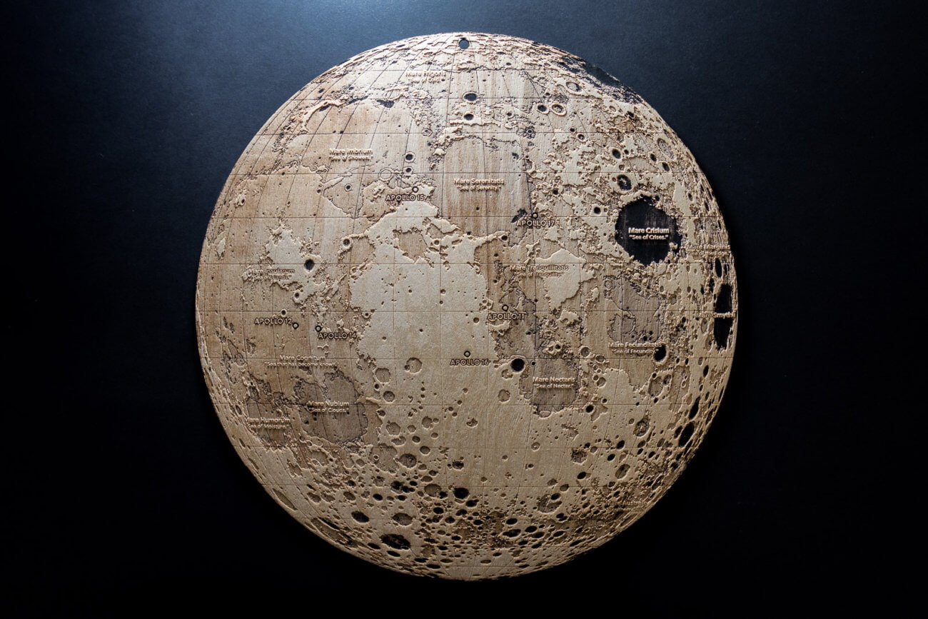 Topographic map of the Moon – Laser engraving in wood by Robin Hanhart