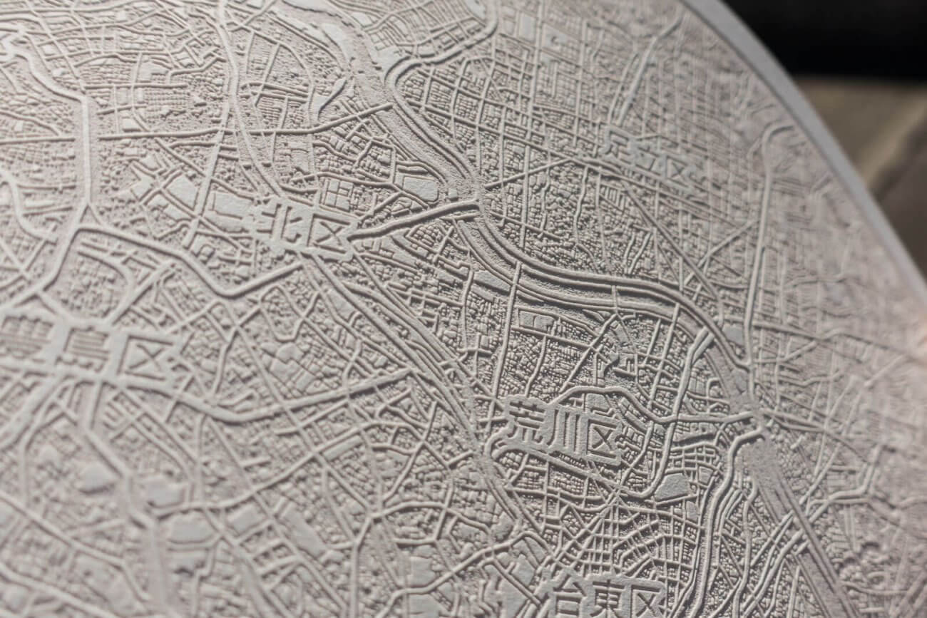 Detail of laser engraving in paper map of Tokio, Japan in 2016