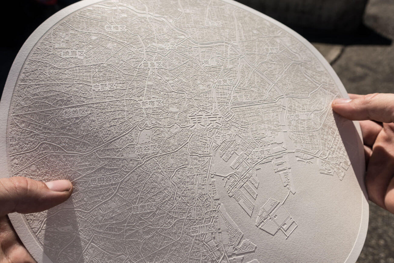 A round laser engraved paper map of Tokio, Japan by Robin Hanhart